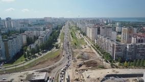 Aerial view of traffic jam of modern russian city in sunny summer day. 4K stock footage