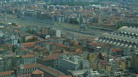 Aerial view of a train approaching and entering Milano Central Station.  stock video