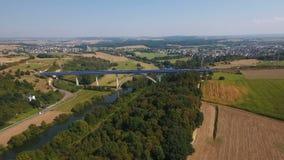 Aerial view of train bridge stock video footage
