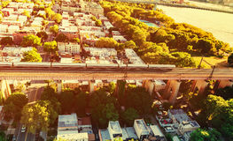 Aerial view of a train crossing the Hell Gate Bridge in NY Royalty Free Stock Photos
