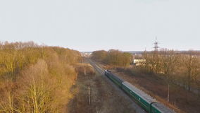 Aerial view of train over railway in the forest. At autumn stock video footage