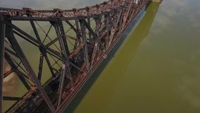 Aerial View of Train on Railroad Bridge Over Ohio River in Western Pennsylvania. 8420 MONACA, PA - Circa April, 2017 - A daytime aerial view of a cargo train stock video footage