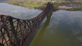 Aerial View of Train on Railroad Bridge Over Ohio River in Western Pennsylvania. 8421 MONACA, PA - Circa April, 2017 - A daytime aerial reverse view of a cargo stock video footage