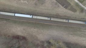 Aerial view of the train on the railway in the countryside. Aerial Photo: Railroad, train rides stock video