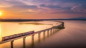 Aerial View The train is running on the bridge Over River Pa Sak Stock Image