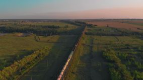 Aerial view of train at sunset stock footage