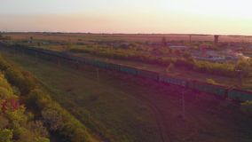 Aerial view of train at sunset stock video