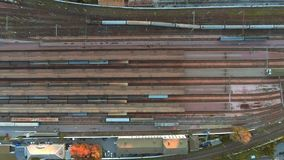 Aerial view. Trains moving out from platform of railway station stock footage