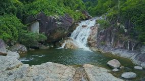 Aerial View Blue Pond among Rocks and Waterfall in Jungle. Aerial view transparent cool blue pond among rocks and beautiful waterfall against wild tropical stock video