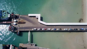 Aerial view of transport queue embarking ferry stock video footage