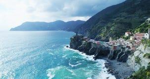 Aerial view of travel landmark destination Vernazza,small mediterranean sea town,Cinque terre National Park, Liguria. Aerial view of travel landmark destination stock video