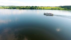 Aerial view of travel ship in river with green banks. Aerial view of ship travel in river stock video