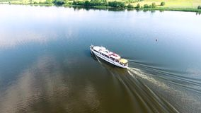Aerial view of travel ship in river with green banks. Aerial view of ship travel in river stock video footage