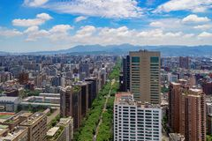 Aerial view of trees tunnel with park garden and skyscrapers buildings. Financial district and business centers in smart urban. City, Taipei at noon, Taiwan stock photos