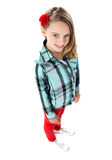 Aerial view of a trendy young girl child. Posing with a red rose on her hair Royalty Free Stock Image