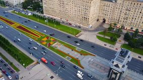 Aerial view on Triumphal Arch, Victory Park in Moscow. Along triumphal arch on Kutuzov avenue moving cars and royalty free stock photos