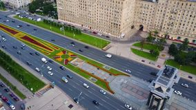 Aerial view on Triumphal Arch, Victory Park in Moscow. Along triumphal arch on Kutuzov avenue moving cars and. Pedestrians 4K stock footage