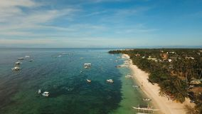 Aerial view beautiful Alona beach on a tropical island Bohol. Philippines. Aerial view of tropica Alona beach on the island Bohol, resort, hotels, Philippines Stock Photo