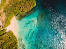 Aerial view of tropical beach with crystal turquoise ocean in Bali, holiday sandy beach, blue lagoon royalty free stock photography