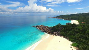 Aerial view of tropical beach (Grand Anse) on La Digue island, Seychelles. stock footage