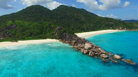 Aerial view of tropical beach (Grand Anse) on La Digue island, Seychelles. stock video footage