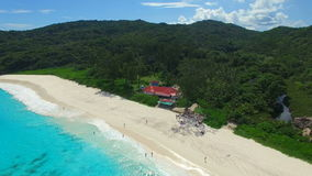 Aerial view of tropical beach (Grand Anse) on La Digue island, Seychelles. stock video