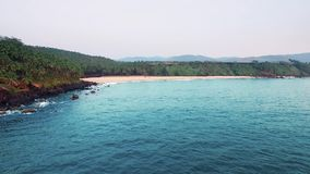 Aerial view tropical beach in india, Goa. Flying on drone, over Indian ocean and coconut palms stock video footage