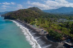 Aerial view of tropical beach on the island of Bali. Aerial drone view of tropical beach on the island of Bali, Indonesia Royalty Free Stock Photography