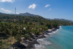 Aerial view of tropical beach on the island of Bali. Aerial drone view of tropical beach on the island of Bali, Indonesia Royalty Free Stock Photos