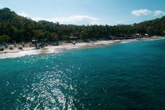Aerial view of tropical beach on the island of Bali. Aerial drone view of tropical beach on the island of Bali, Indonesia Stock Photo