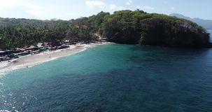 Aerial view of tropical beach on the island of Bali. Aerial drone view of tropical beach on the island of Bali, Indonesia stock video footage
