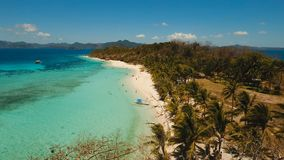 Aerial view beautiful beach on a tropical island Malcapuya. Philippines. Aerial view of tropical beach on the island Malcapuya, Palawan, Philippines. Beautiful stock video footage