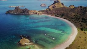 Aerial view of tropical beach on Padar Island. Beautiful aerial view footage of tropical beach with white sand and turquoise water on Padar Island, an island stock video footage