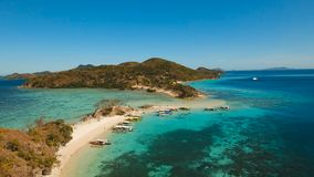 Aerial view beautiful beach on a tropical island. Coron, Palawan, Philippines. Aerial view of tropical beach with beach,resort, hotels. Philippines. Beautiful stock video