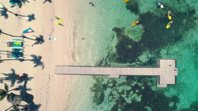 Aerial view of tropical beach and sea activities for sport, fun, leisure or recreational pursuit near Punta Cana stock video footage