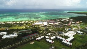 Aerial view of tropical Caribbean beach resort and golf course. Punta Cana. Dominican Republic stock video footage