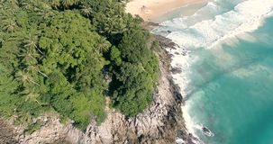 Aerial view of tropical island beach. Aerial drone view of beautiful tropical island  sandy beach and sea waves crashing coastline crocks during sunny summer day stock video
