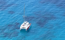 Aerial view of tropical island beach holiday yacht on blue reef ocean Stock Photography