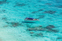 Aerial view of the tropical island, clear blue sea and a boat at Stock Image