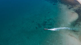 Aerial view of tropical island clear blue sea. Summer clear blue sea at Koh Phangan, Suratthani, Thailand Royalty Free Stock Image