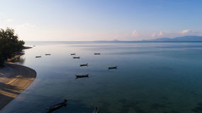 Aerial view of tropical island clear blue sea. Summer morning clear blue sea at Koh Phangan, Suratthani, Thailand Royalty Free Stock Photography