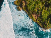 Aerial view of tropical island with cliff, rocks and ocean in Bali Stock Image