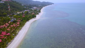 Aerial view of tropical island coastline with hotels. Shot with a Sony a6300 fps29,97 4k stock video footage