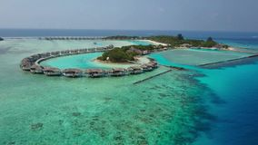 Aerial view of tropical island resort hotel with white sand palm trees and turquoise Indian ocean on Maldives stock video