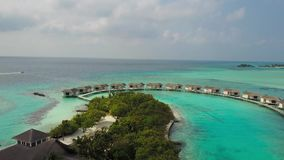 Aerial view of tropical island resort hotel with white sand palm trees and turquoise Indian ocean on Maldives stock video footage