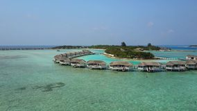 Aerial view of tropical island resort hotel with white sand palm trees and turquoise Indian ocean on Maldives, Camera stock footage