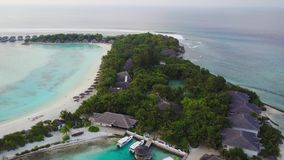 Aerial view of tropical island resort hotel with white sand palm trees and turquoise Indian ocean on Maldives, dock stock video footage