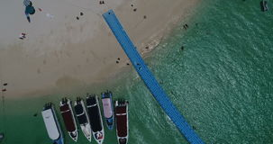 Aerial view of the tropical island and sea. Aerial view of tropical island Koh Khai Nai and sea with moored yachts stock footage