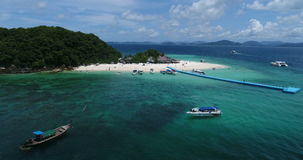 Aerial view of the tropical island and sea. Aerial view of tropical island Koh Khai Nai and sea with moored yachts stock video footage