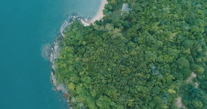 Aerial view of the tropical island and sea. Top view drone flyover tropical island and sea - video in slow motion stock video